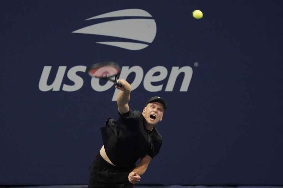 Jenson Brooksby, of the United States, serves the ball during the first round of the US Open tennis championships, Tuesday, Aug. 31, 2021, in New York. (AP Photo/Elise Amendola)