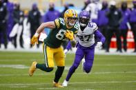 Green Bay Packers' Jace Sternberger catches a pass in front of Minnesota Vikings' Cameron Dantzler during the first half of an NFL football game Sunday, Nov. 1, 2020, in Green Bay, Wis. (AP Photo/Matt Ludtke)