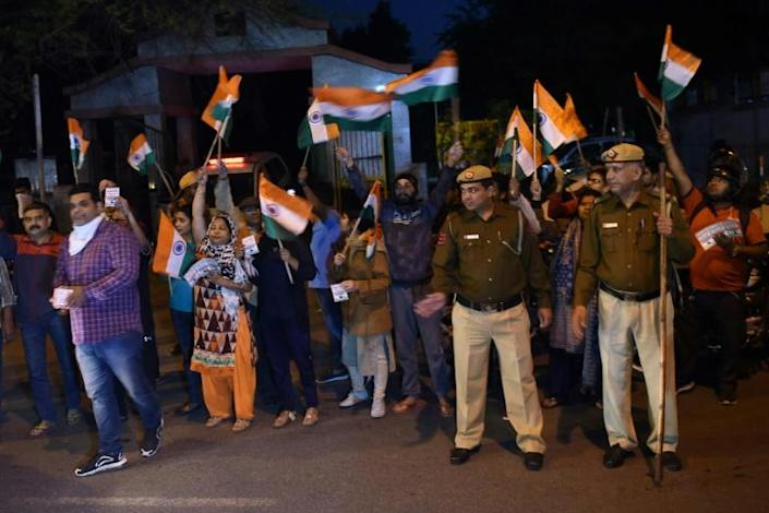 Celebrations outside the gates of Tihar Jail in New Delhi marked the execution of four men convicted of the 2012 gang-rape and murder of a student (AFP Photo/Money SHARMA)