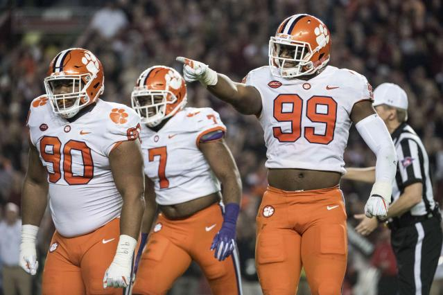 "Clemson defensive end Clelin Ferrell (99), <a class=""link rapid-noclick-resp"" href=""/ncaaf/players/264383/"" data-ylk=""slk:Dexter Lawrence"">Dexter Lawrence</a> (90) and Austin Bryant (7) react after a sack during the first half of an NCAA college football game against South Carolina on Saturday, Nov. 25, 2017, in Columbia, S.C. Clemson defeated South Carolina 34-10. (AP Photo/Sean Rayford)"