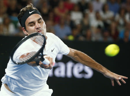 Tennis - Australian Open - Rod Laver Arena, Melbourne, Australia, January 20, 2018. Roger Federer of Switzerland hits a shot against Richard Gasquet of France. REUTERS/Thomas Peter