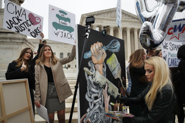 <p>As Janae Stracke, left, and Annabelle Rutledge, both with Concerned Women for America, hold up signs, as Jessica Haas, of Indianapolis, paints during a rally with supporters of cake artist Jack Phillips outside of the Supreme Court which is hearing the 'Masterpiece Cakeshop v. Colorado Civil Rights Commission' today, Tuesday, Dec. 5, 2017, in Washington. (Photo: Jacquelyn Martin/AP) </p>