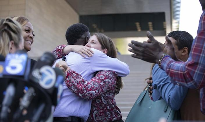 LOS ANGELES, CA - JULY 27: Assistant U.S. Atty. Lindsay Bailey hugs surviving victim Dane Brown following Ed Buck's guilty verdict on Tuesday, July 27, 2021 in Los Angeles, CA. (Myung J. Chun / Los Angeles Times)