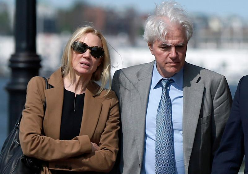 FILE - In this May 22, 2019 file photo, Marcia, left, and Gregory Abbott leave federal court after they pleaded guilty to charges in a nationwide college admissions bribery scandal. They are scheduled to be sentenced on Tuesday, Oct. 8. (AP Photo/Michael Dwyer, File)