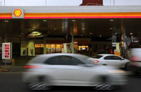 Cars pass by a Shell gas station in Buenos Aires