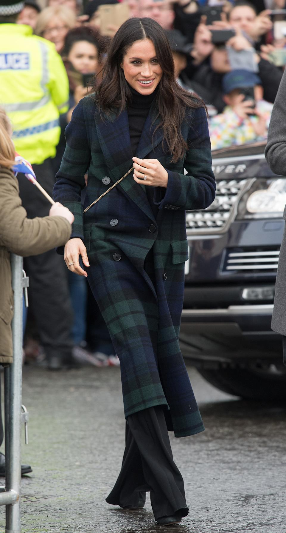 <p>Markle's tartan Burberry jacket marked the birth of a style star during a trip to Edinburgh, Scotland in February 2018 with then fiancé, Prince Harry. <em>(Image via Getty Images)</em></p>