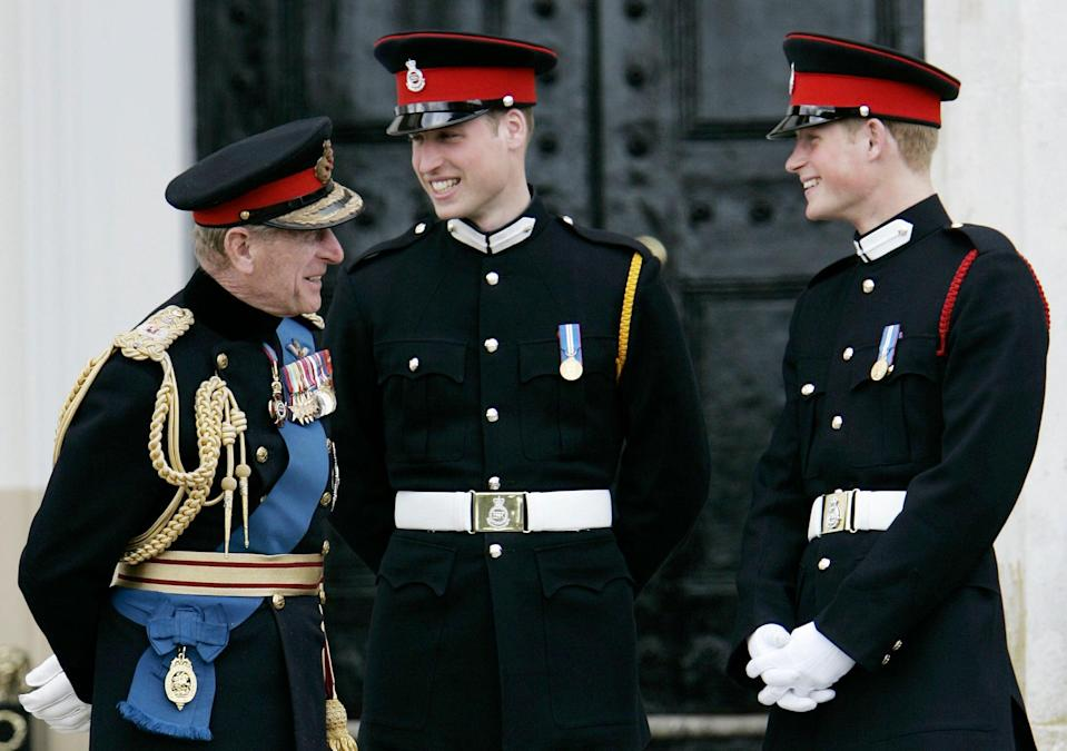 Prince Phlip, Prince William and Prince HarryAP