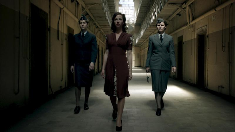 """The undated photo provided by German TV broadcaster ZDF shows Greta (Katharina Schuettler) walking through a prison in a scene of the wartime drama 'Our mothers, our fathers' (Unsere Muetter, unsere Vaeter). With the wartime generation rapidly disappearing, the television drama about five young Germans in World War II has revived debate in Germany about the role ordinary men and women played in the Nazis' murderous campaign to conquer Europe. Millions tuned in last week to watch the three-part series """"Our Mothers, Our Fathers,"""" which follows five young Germans _ two brothers, a nurse, an aspiring female singer and a Jewish tailor _ as they struggle through one of the bloodiest conflicts in history. (AP Photo/ZDF, David Slama)"""