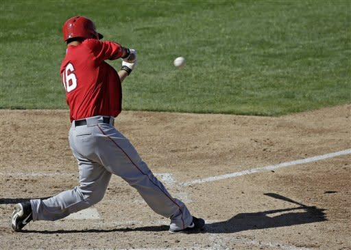 Los Angeles Angels' Hank Conger hits a two-run single during the sixth inning of an exhibition spring training baseball game against the Milwaukee Brewers, Saturday, March 2, 2013, in Phoenix. (AP Photo/Morry Gash)