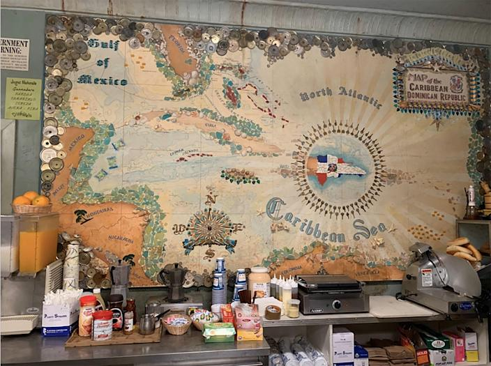 The film's scenic department created a historic map of the Dominican Republic for the bodega. Coates also designed a painted mural on the side of the market with an image of a man in a boat dreaming of the day he returns to the island.