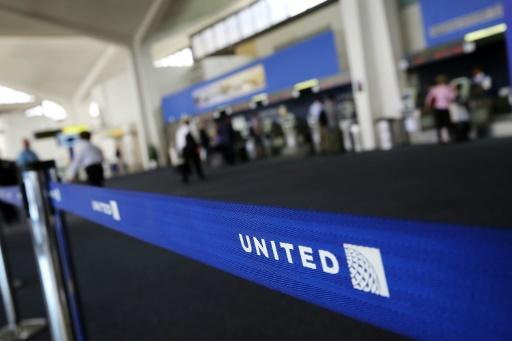 United settles with dragged passenger, changes practices