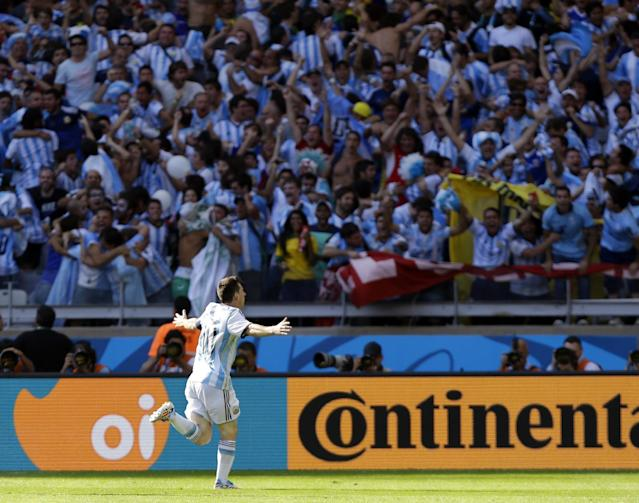 Argentina's Lionel Messi celebrates after scoring his side's lone goal in Argentina's 1-0 victory over Iran during the group F World Cup soccer match between Argentina and Iran at the Mineirao Stadium in Belo Horizonte, Brazil, Saturday, June 21, 2014. (AP Photo/Fernando Vergara)