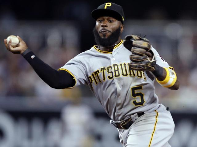 "<a class=""link rapid-noclick-resp"" href=""/mlb/players/8950/"" data-ylk=""slk:Josh Harrison"">Josh Harrison</a> made a new fan during the Pirates trip to Milwaukee this week. (AP)"