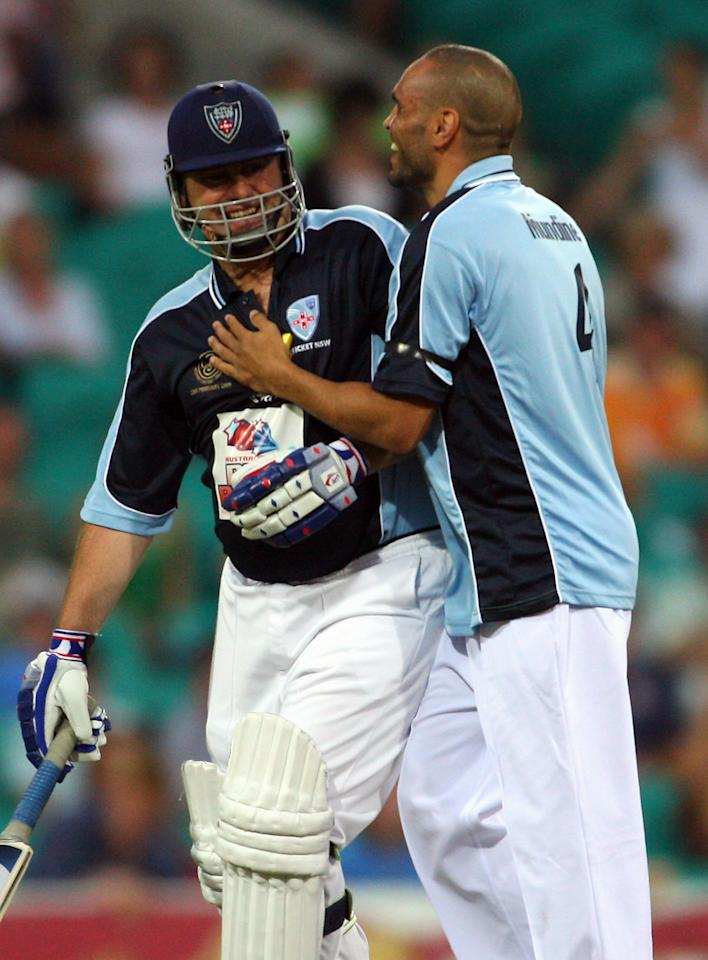 SYDNEY, AUSTRALIA - FEBRUARY 22:  Anthony Mundine of Waugh's XI jokes around with Mark Taylor of Taylor's XI during the Australia's Big Bash Twenty20 Victorian Bushfire Appeal charity match at the Sydney Cricket Ground on February 22, 2009 in Sydney, Australia.  (Photo by Cameron Spencer/Getty Images)