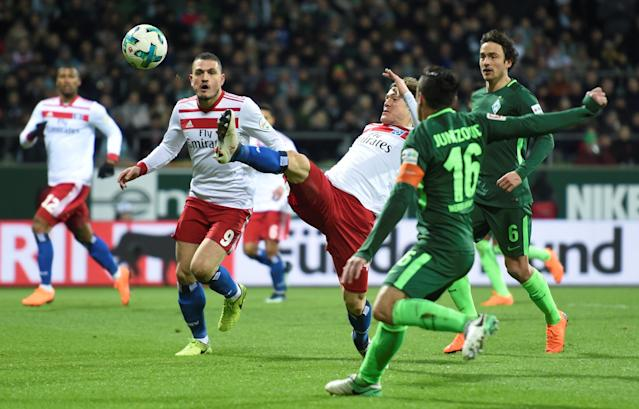 Soccer Football - Bundesliga - Werder Bremen vs Hamburger SV - Weser-Stadion, Bremen, Germany - February 24, 2018 Werder Bremen's Zlatko Junuzovic in action with Hamburg's Gotoku Sakai REUTERS/Fabian Bimmer DFL RULES TO LIMIT THE ONLINE USAGE DURING MATCH TIME TO 15 PICTURES PER GAME. IMAGE SEQUENCES TO SIMULATE VIDEO IS NOT ALLOWED AT ANY TIME. FOR FURTHER QUERIES PLEASE CONTACT DFL DIRECTLY AT + 49 69 650050