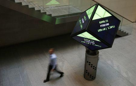A man walks through the lobby of the London Stock Exchange in London