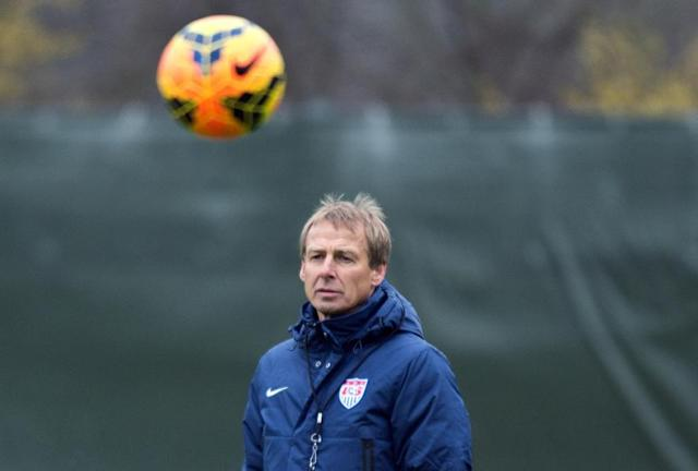 Juergen Klinsmann, coach of the US American national soccer team, leads a training session of his team in Frankfurt Germany, Monday March 3, 2014. The USA will face Ukraine on Cyprus on Wednesday. (AP Photo/dpa,Boris Roessler)