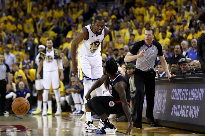 Oakland, Calif. - April 13: Kevin Durant's No. 35 Golden State Warriors has words with No. 21 Patrick Beverley of the LA Clippers in the first game of the first round of the 2019 NBA Western Conference Playoffs at ORACLE Arena on April 13, 2019 in Oakland, California. Both players were ejected after the game. NOTE TO USER: The user acknowledges and expressly agrees that by downloading and / or using this photo, the user agrees to the Getty Images License Terms and Conditions. (Photo by Ezra Shaw / Getty Images)