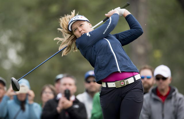 Brooke Henderson, of Smiths Falls, Ontario, tees off of the fifth hole during the women's Canadian Open golf tournament in Regina, Saskatchewan, Saturday, Aug. 25, 2018. (Jonathan Hayward/The Canadian Press via AP)