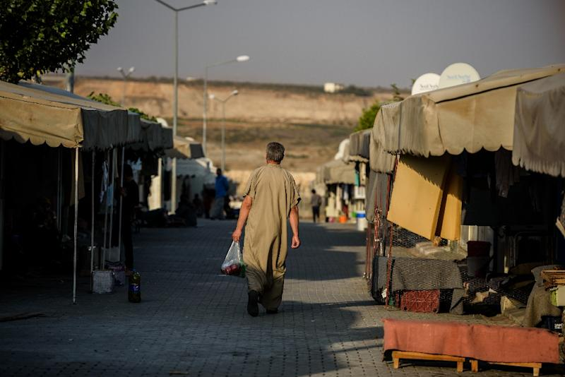 A Syrian man walks at a refugee camp in the Kilis district of Gaziantep, southeastern Turkey, on October 23, 2016
