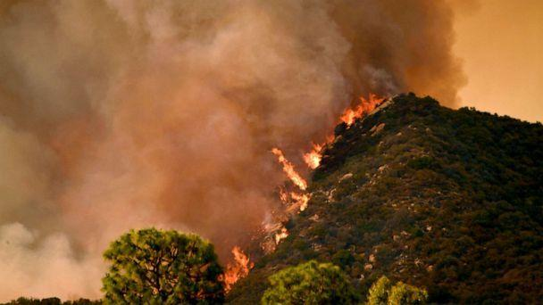 PHOTO: Flames from the Palisades fire are seen cresting a hill in Topanga State Park in Los Angeles, May 15, 2021. (Patrick T. Fallon/AFP via Getty Images)