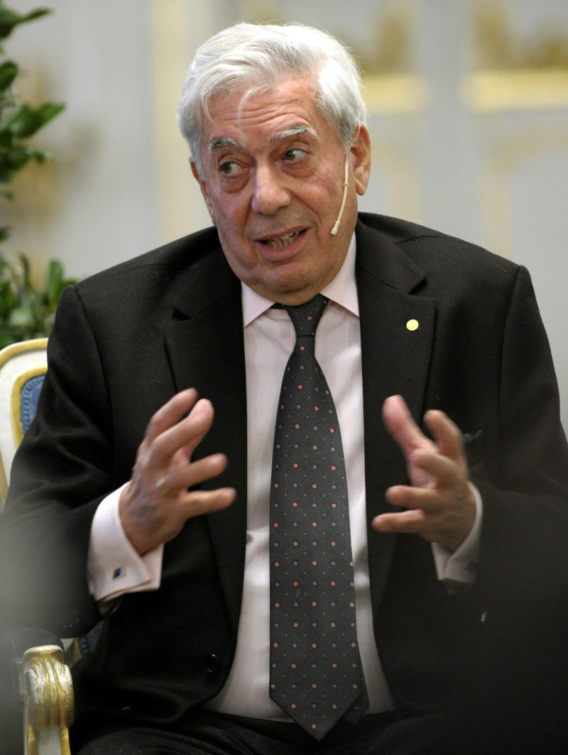 The 2010 Nobel Prize for Literature laureate Mario Vargas Llosa gestures during the press conference at the 'Borssalen' hall at the Old Stock Exchange in Stockholm, Sweden,  Monday Dec, 6, 2010. The award ceremony for this year's Nobel Prizes will be held on Dec, 10.  (AP Photo / Janerik Henriksson / SCANPIX)  SWEDEN OUT