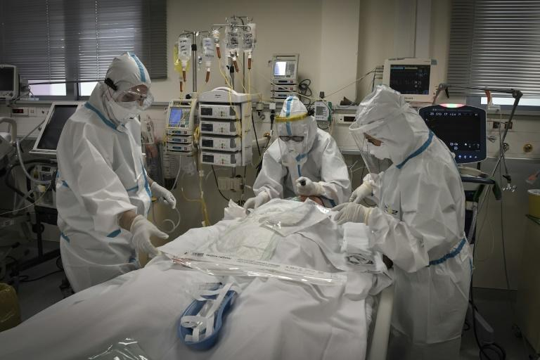 "G20 leaders will pledge to ""spare no effort"" in ensuring the equitable distribution of coronavirus vaccines worldwide. This picture shows nurses helping a Covid-19 patient at an Athens hospital"