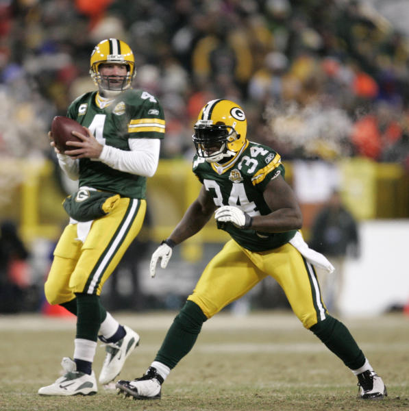 File-This Jan. 20, 2008, file photo shows Green Bay Packers quarterback Brett Favre (4) dropping back to pass with Vernand Morency (34) blocking during the NFC Championship football game in Green Bay, Wis. Members of a special panel of 26 selected all of them for the position as part of the NFL's celebration of its 100th season. All won league titles except Marino. All are in the Hall of Fame except Brady and Manning, who are not yet eligible.  On Friday, Dec. 27, 2019, quarterback was the final position revealed for the All-Time Team. (AP Photo/Mike Roemer, File)
