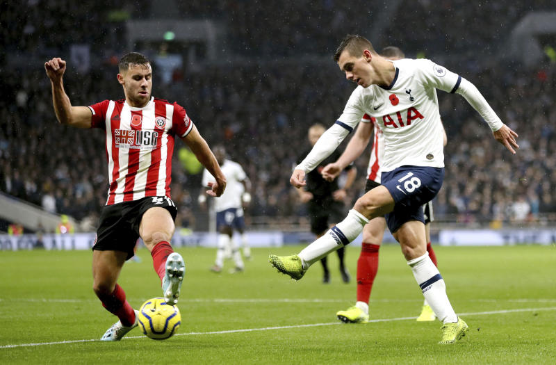 Sheffield United's George Baldock, left and Tottenham Hotspur's Giovani Lo Celso battle for the ball, during the English Premier League soccer match between Tottenham Hotspur and Sheffield United, at Tottenham Hotspur Stadium, in London,  Saturday, Nov. 9, 2019. (Bradley Collyer/PA via AP)