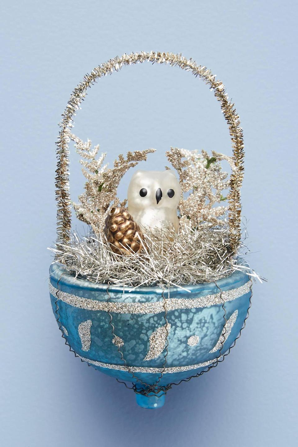 """<p>Give your tree a frosted woodland touch with this <a href=""""https://www.popsugar.com/buy/Owl-Nest-Ornament-490544?p_name=Owl%27s%20Nest%20Ornament&retailer=anthropologie.com&pid=490544&price=20&evar1=casa%3Aus&evar9=46615300&evar98=https%3A%2F%2Fwww.popsugar.com%2Fhome%2Fphoto-gallery%2F46615300%2Fimage%2F46615415%2FOwl-Nest-Ornament&list1=shopping%2Canthropologie%2Choliday%2Cchristmas%2Cchristmas%20decorations%2Choliday%20decor%2Chome%20shopping&prop13=mobile&pdata=1"""" rel=""""nofollow noopener"""" class=""""link rapid-noclick-resp"""" target=""""_blank"""" data-ylk=""""slk:Owl's Nest Ornament"""">Owl's Nest Ornament</a> ($20).</p>"""