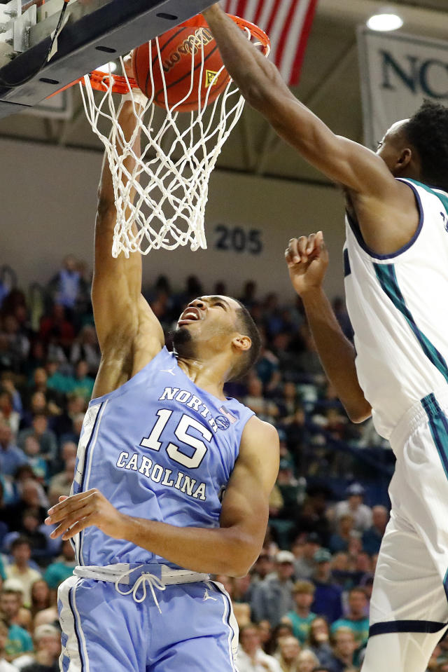 North Carolina's Garrison Brooks (15) scores after driving past UNC Wilmington 's John Bowen (32) during the first half of an NCAA college basketball game in Wilmington, N.C., Friday, Nov. 8, 2019. (AP Photo/Karl B DeBlaker)