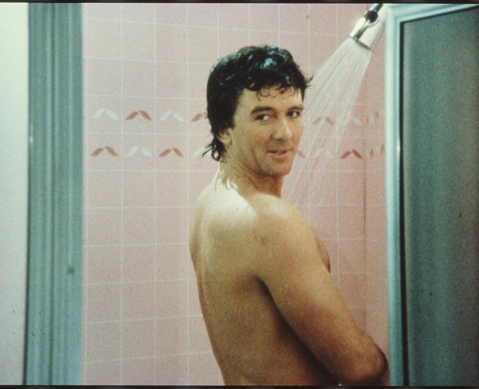 In a scene from the American television series 'Dallas,' American actor Patrick Duffy (as Bobby Ewing) stands in the shower and looks over his shoulder in an episode called 'Blast From the Past,' May 1986. (Photo by CBS Photo Archive/Getty Images)