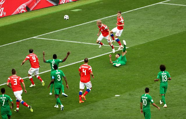 <p>Russia's Yury Gazinsky got the hosts off and running when his back post header opened the scoring after 12 minutes. (Getty) </p>
