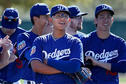 Julio Urias looks on during a spring training workout on Saturday in Glendale, Arizona. (Getty)