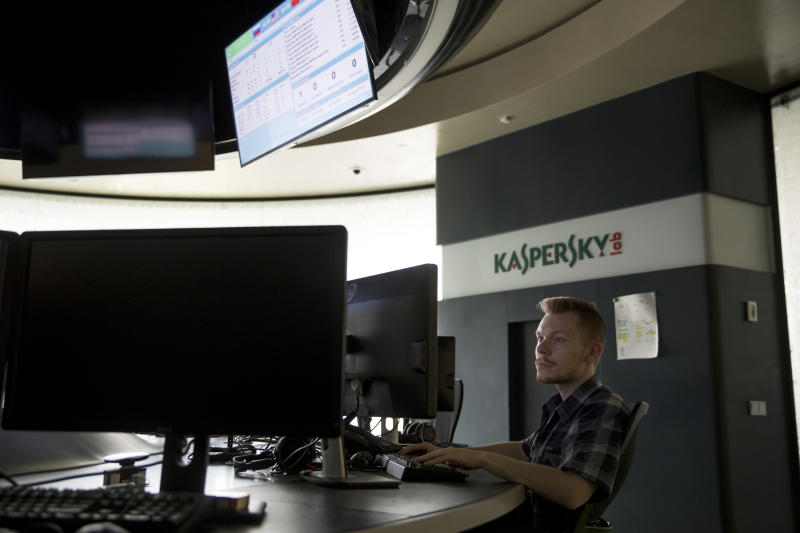 FILE - In this Saturday, July 1, 2017, file photo, an employee of Kaspersky Lab works on computers at the company's headquarters in Moscow. Worries rippled through the consumer market for antivirus software after the U.S. government banned federal agencies from using Kaspersky Lab software on Wednesday, Sept. 13, 2017. Best Buy said it will no longer sell software made by the Russian company, although one security researcher said most consumers don't need to be alarmed. (AP Photo/Pavel Golovkin, File)