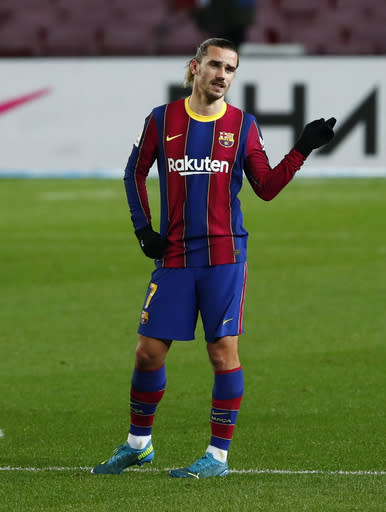 Barcelona's Antoine Griezmann gestures during the Spanish La Liga soccer match between Barcelona and Eibar at the Camp Nou stadium in Barcelona in Barcelona, Spain, Tuesday, Dec. 29, 2020. (AP Photo/Joan Monfort)