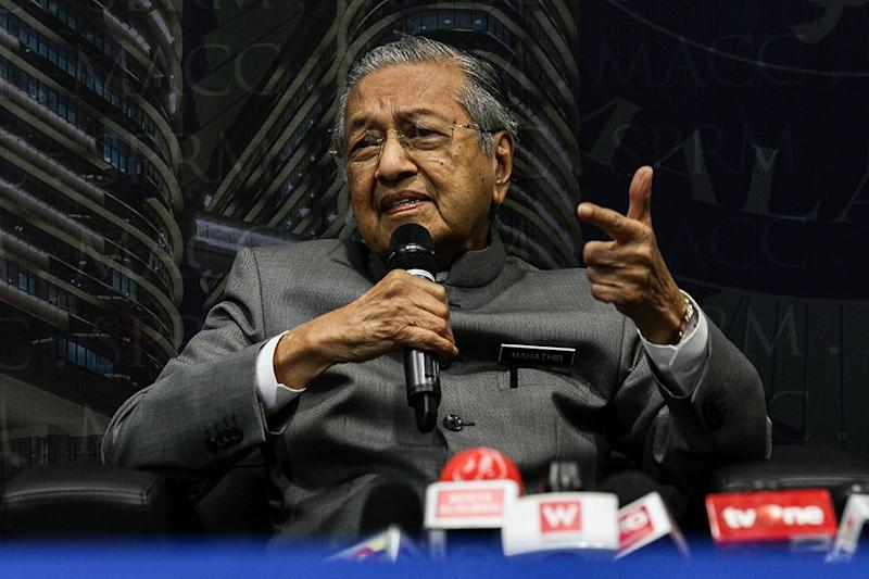 Tun Dr Mahathir Mohamad said today Malaysia will just become a 'nation of consumers' if its people are unwilling to take a risk and set up a second national car. — Picture by Miera Zulyana