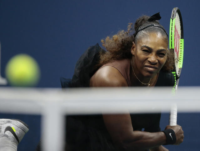 Serena Williams serves to Naomi Osaka, of Japan, during the women's final of the U.S. Open tennis tournament, Saturday, Sept. 8, 2018, in New York. (AP Photo/Andres Kudacki)