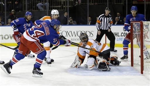 New York Rangers right wing Ryan Callahan (24) scores a goal on Philadelphia Flyers goalie Ilya Bryzgalov (30), from Russia, in the second period of their NHL hockey game at Madison Square Garden in New York, Tuesday, Jan. 29, 2013. The goal made Callahan's 200th point. (AP Photo/Kathy Willens)