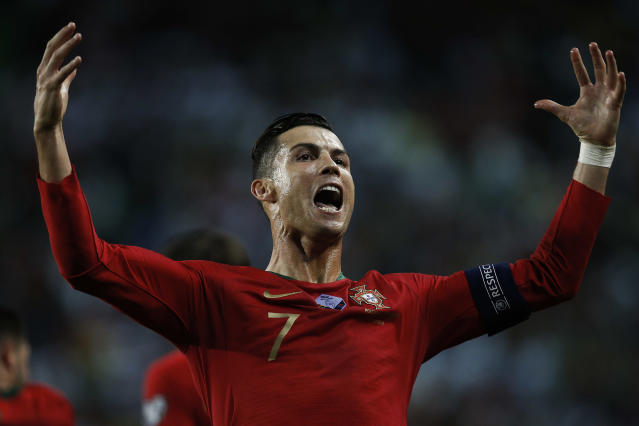 Cristiano Ronaldo of Portugal celebrates his goal during the Euro 2020 qualifying match football match between Portugal v Luxembourg. (Credit: Getty Images)