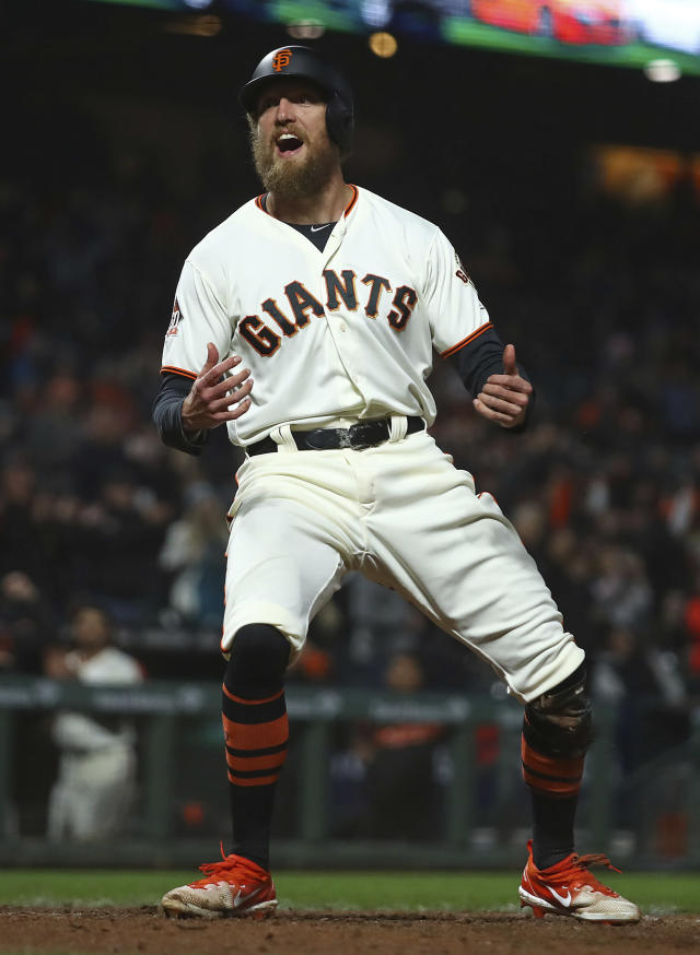 San Francisco Giants' Hunter Pence celebrates after scoring against the San Diego Padres during the seventh inning of a baseball game Tuesday, Sept. 25, 2018, in San Francisco. (AP Photo/Ben Margot)