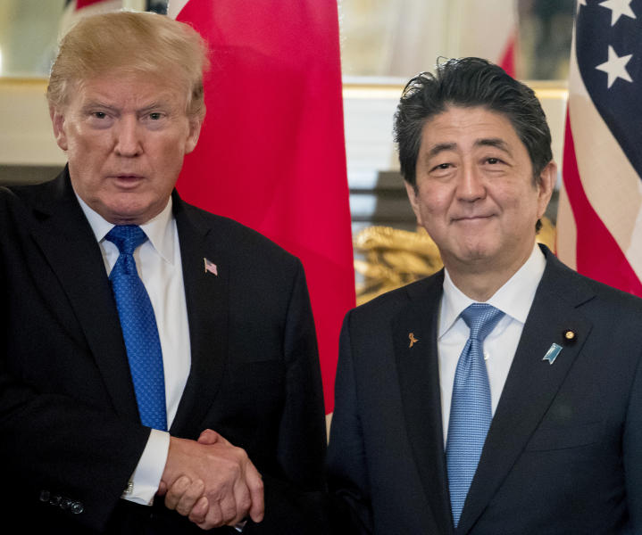 FILE - In this Nov. 6, 2017, file photo, U.S. President Donald Trump, left, and Japanese Prime Minister Shinzo Abe shake hands before a bilateral meeting at the Akasaka Palace in Tokyo. Trump will make a state visit to Japan at the end of May, 2019 to meet the nation's new emperor. (AP Photo/Andrew Harnik, File)