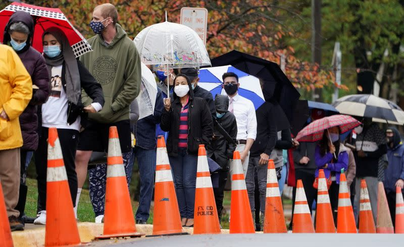 Early voters line up in the rain in Annandale, Virginia