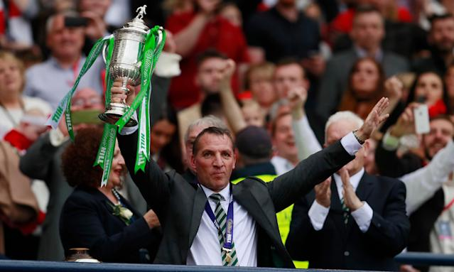 Brendan Rodgers celebrates after Celtic beat Aberdeen in the 2017 Scottish Cup final to complete a treble and and an unbeaten domestic season.