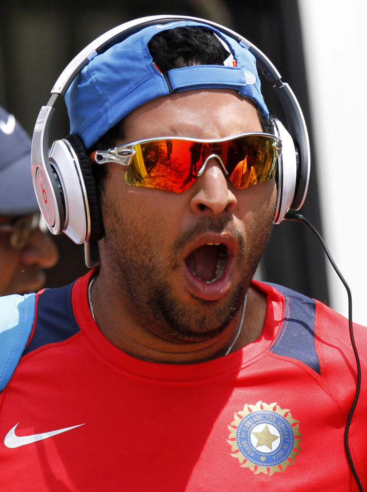 India's Yuvraj Singh yawns as he arrives for a practice session ahead of their Cricket World Cup Group B match with Kenya in Chennai, India, Wednesday, March 16, 2011.
