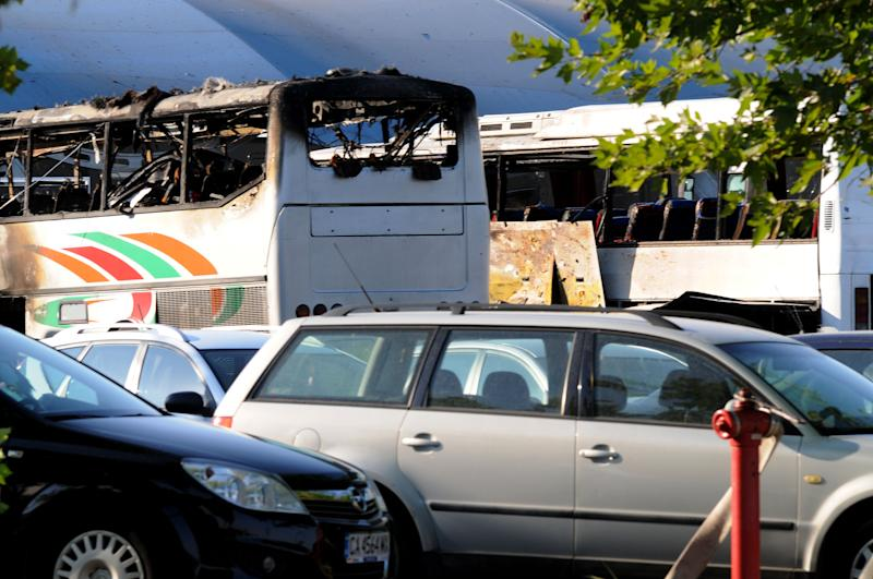 Destroyed buses are seen at Burgas airport, outside the Black Sea city of Burgas, Bulgaria, some 400 kilometers (250 miles) east of the capital, Sofia, Wednesday, July 18, 2012. A bus carrying young Israeli tourists in a Bulgarian resort exploded Wednesday, killing three people and wounding at least 20, police said. Witnesses told Israeli media that the huge blast occurred soon after someone boarded the vehicle. (AP Photo/ Bulphoto Agency) BULGARIA OUT