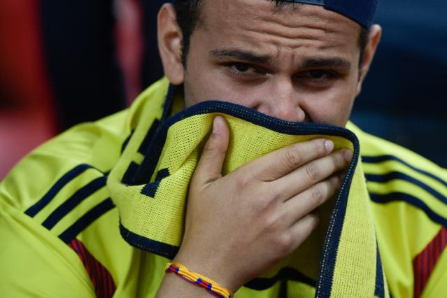 <p>A Colombia fan cries after his team lost the penalty shootout at the end of the Russia 2018 World Cup round of 16 football match between Colombia and England at the Spartak Stadium in Moscow on July 3, 2018. (Photo by Juan Mabromata / AFP) </p>