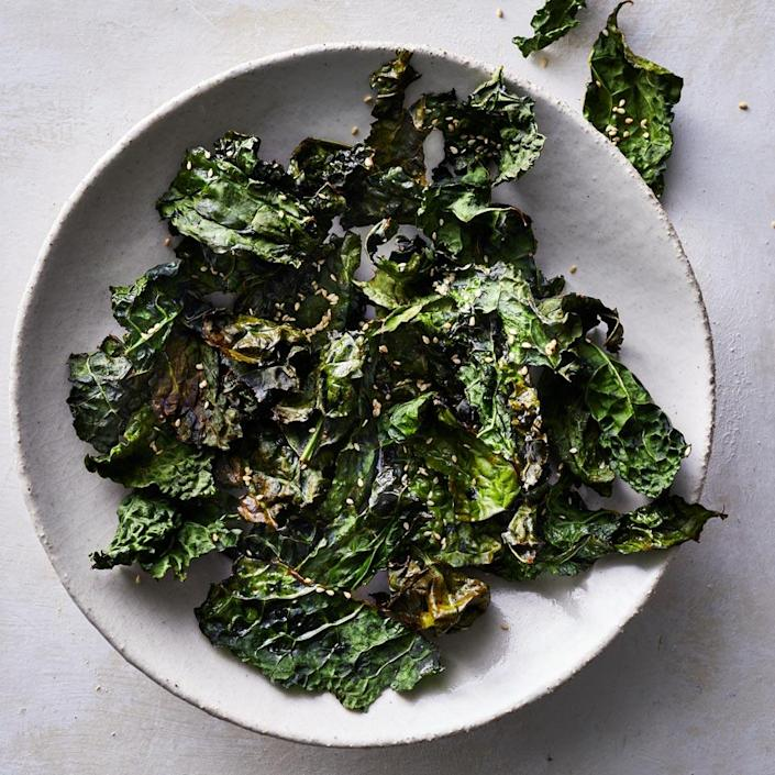 <p>Homemade kale chips are incredibly easy to make. Thanks to the air fryer, fresh kale leaves turn extra crispy in under 15 minutes with much less fat than some store-bought options. Warning: These will go fast!</p>