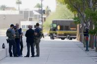 Federal law enforcement personnel stand outside the Sandra Day O'Connor Federal Courthouse Tuesday, Sept. 15, 2020, in Phoenix. A drive-by shooting wounded a federal court security officer Tuesday outside the courthouse in downtown Phoenix, authorities said. The officer was taken to a hospital and is expected to recover, according to city police and the FBI, which is investigating. (AP Photo/Ross D. Franklin)