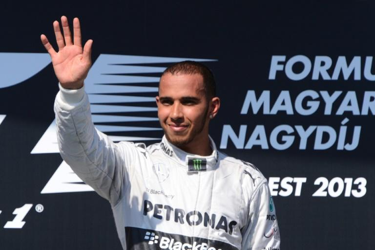 On top: Hamilton celebrates victory at the 2013 Hungarian Grand Prix
